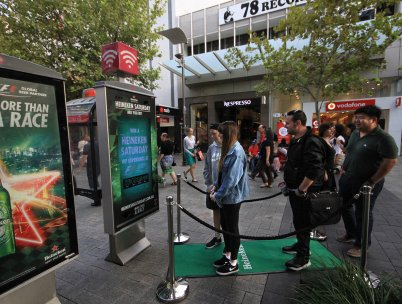Olena Khumala and Heineken challenge F1 fans to win tickets to the exclusive event via live stream OOH panel, JCDecaux Australia Mar 2017
